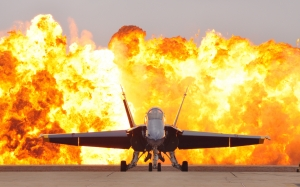 air show pyrotechnics, military jet, f-18, hornet, blue angel, flightline, detonation, dramatic effect, plane, airplane, aircraft, entertainment, ground, flames, fire