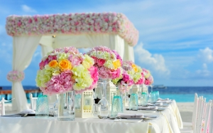 beach, bunch of flowers, celebration, chairs, colorful, colourful, decorations, flowers, island, sea, summer, table, tropical, water, wedding