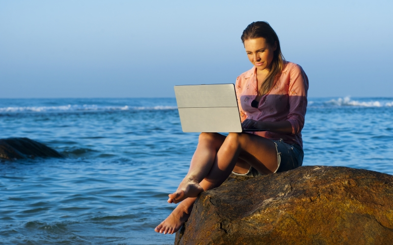 beach, lady, laptop, leisure, ocean, people, person, relaxation, rocks, sea, seashore, summer, sun, sunset, travel, vacation, wave, woman, working