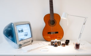 old computer, mac, guitar, desk, lamp, camera, imac g3