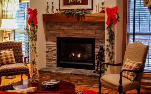 fireplace, mantel, living room, cozy, christmas, xmas, chairs, seating, stone fireplace, family room, decorations, pine garland, holiday, interior design