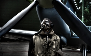 pilot, standing plane, airplane, jacket, aircraft, aviation, vintage, man, person, men, transport, wing, engine, helmet, goggles, propeller