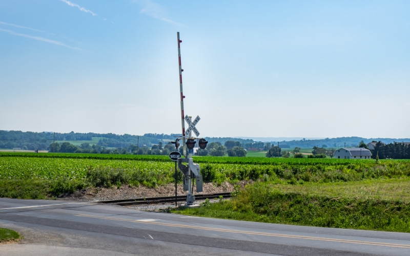 blue sky, farm, field, green, landscape, railroad, rural, summer, road, gate, barrier, countryside