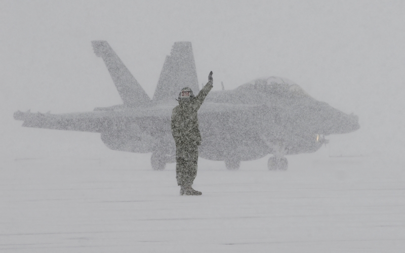 sailor, ea-18g, snow storm, blizzard, winter, military aircraft, fighter