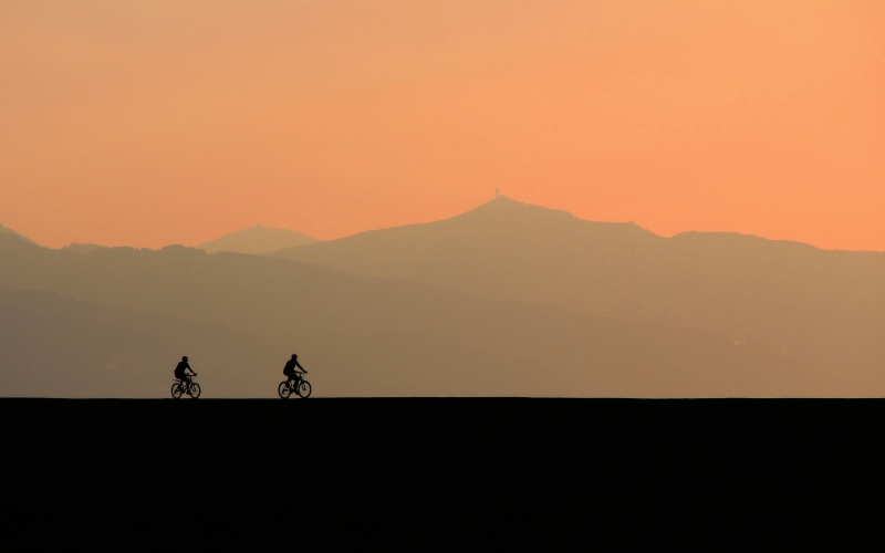backlit, bicycles, clouds, cyclist, dawn, dusk, evening, landscape, mist, mountain, nature, outdoors, scenic, silhouette, sky, sunset, travel
